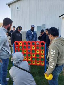 Environmental Management, Inc. staff at appreciation day playing giant connect 4